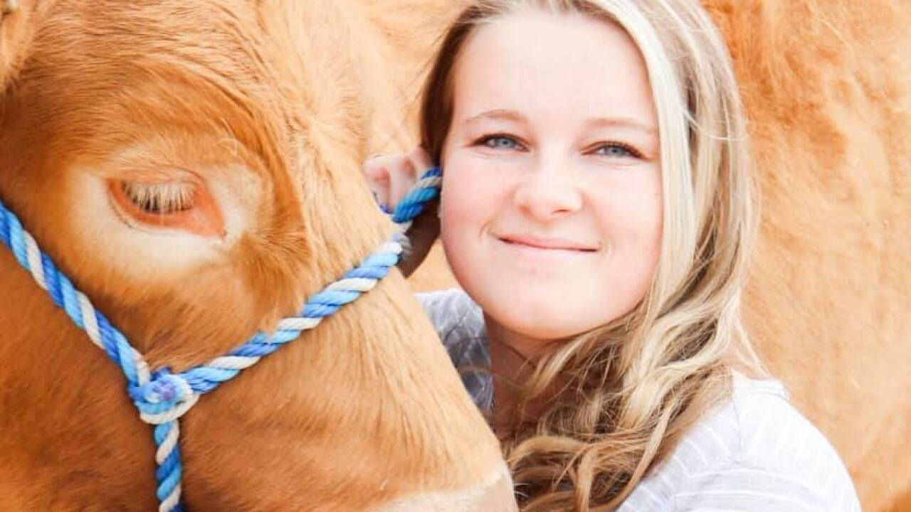 Annie Stephens with her Steer for her senior year