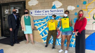 PACE center for girls deliver bags to elder care
