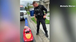wptv-orlando-officer-pulls-over-young-daughter-toy-car.jpg