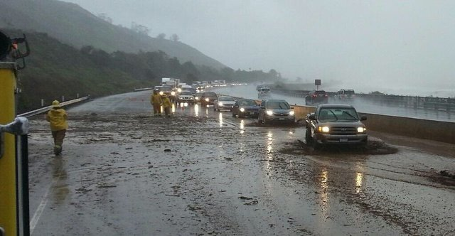 Floods swallow California as severe storms kill three