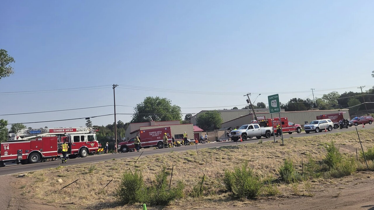 Authorities say a cyclist has died after he was struck by an Arizona driver who plowed his pickup truck into a group of people participating in a bike race. AP photo.