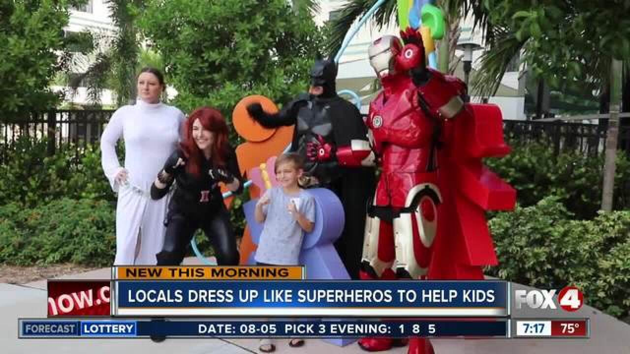 Local superheroes surprise sick kids