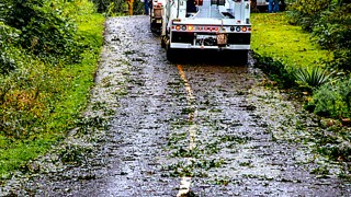 Road crews clear drainage systems in anticipation of Hurricane Florence's rains