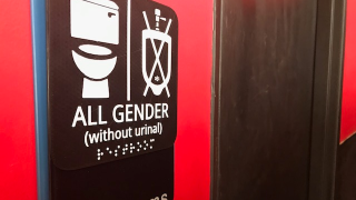 A sign of gender-neutral bathrooms at Ian's Pizza