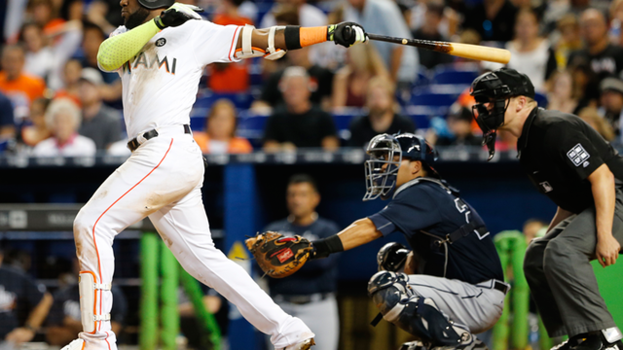 Miami Marlins agree to deal Marcell Ozuna to the St. Louis Cardinals, AP source says