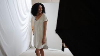 A model wearing Faceplant Dreams sleepwear for a photoshoot in Ybor City.