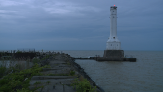Emergency officials urge people to be cautious after man falls off pier into Lake Erie