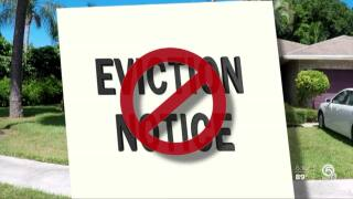 'Eviction Notice' strikeout sign in front of home