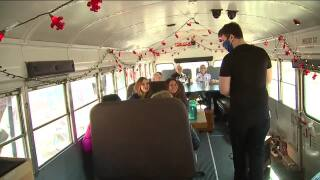 Arvada bar uses old school bus to expand seating during COVID