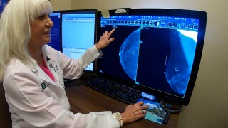 Dr. Kathy Schilling looks at mammogram