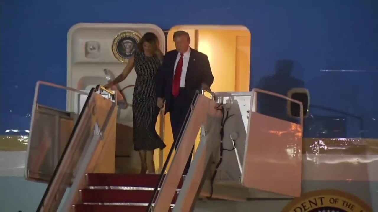 President Donald Trump and first lady Melania Trump arrive at Palm Beach International Airport, Dec. 23, 2020