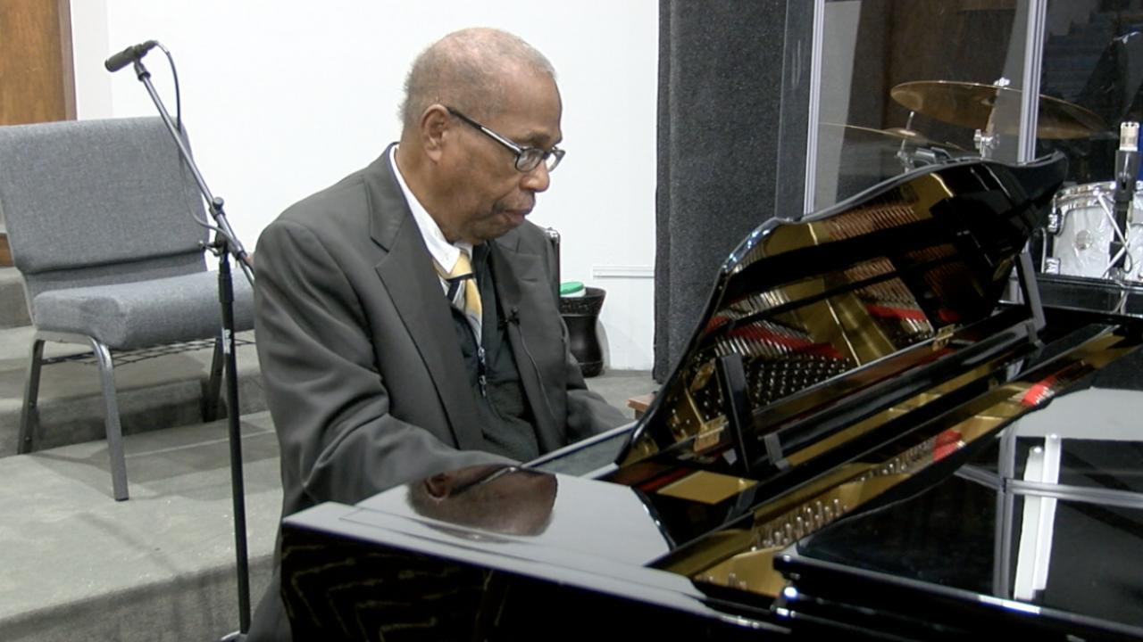 Rev. Dennis Freeman at the piano