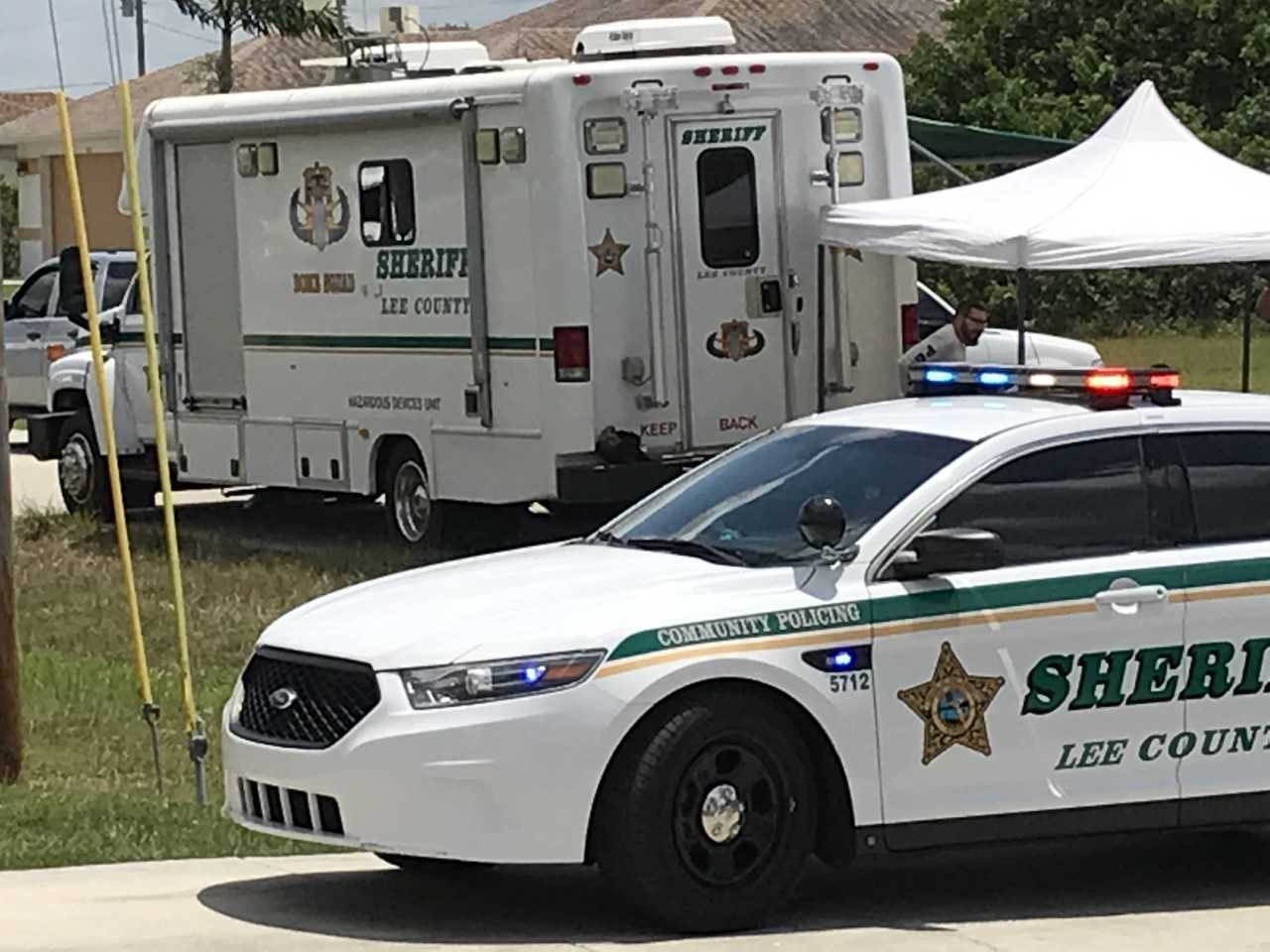 Authorities stationed outside a Cape Coral home on April 30, 2019.