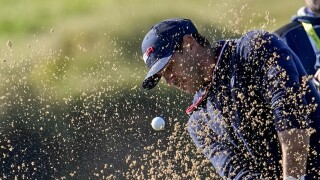 Brooks Koepka hits from bunker on eighth hole at Ryder Cup, Sept. 25, 2021