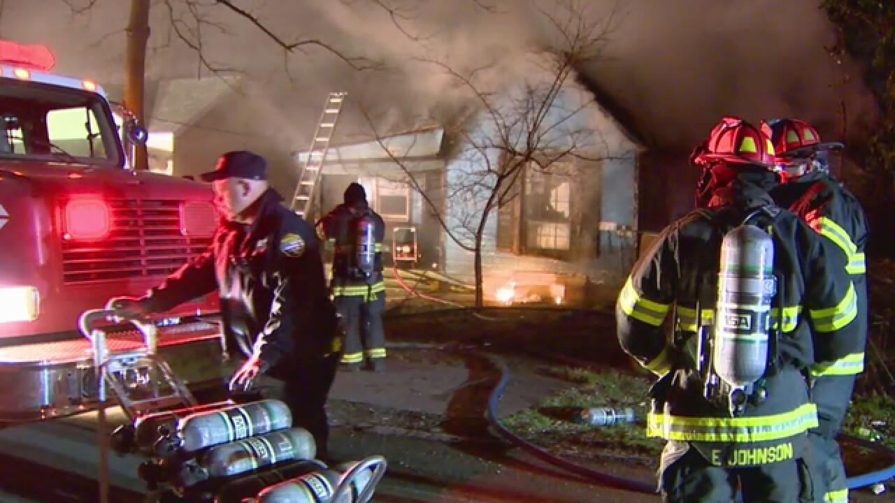 Firefighters Rescue Man From Burning Home