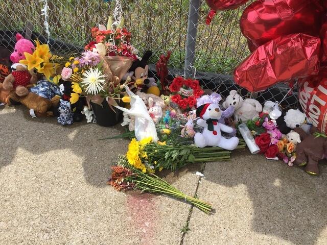 PHOTOS: Memorial for Facebook shooting victim Robert Godwin Sr. on East 93rd continues to grow