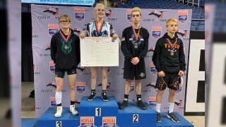 Teen becomes first female wrestler to win individual state title in North Carolina