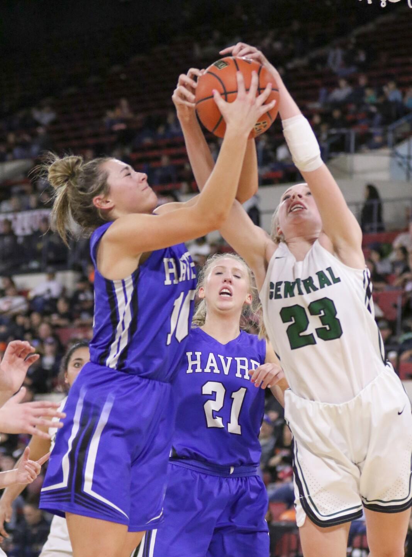 Kyndall Keller and Isabelle Erickson fight for a rebound.jpg