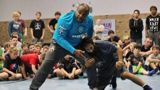UFC heavyweight champion Daniel Cormier shares knowledge with Great Falls wrestlers