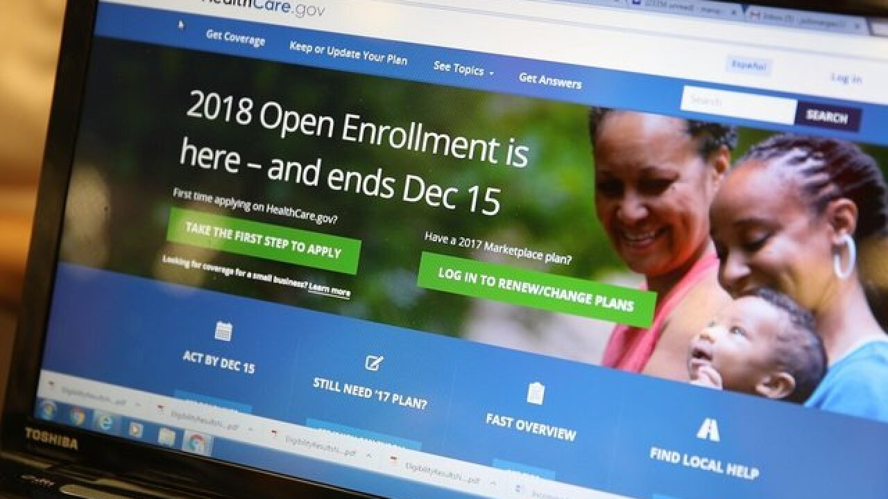 Trump slashes funding that helps people sign up for Obamacare