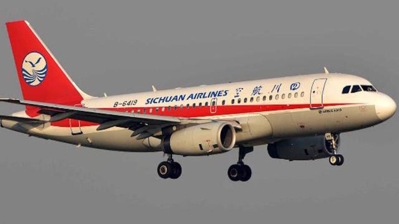 Sichuan Airlines co-pilot sucked halfway out of cockpit window