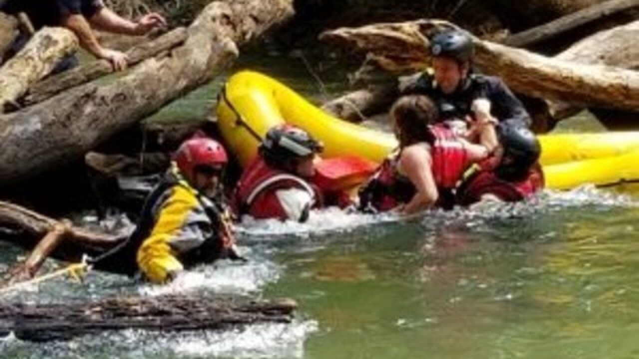 People trapped by debris in river rescued