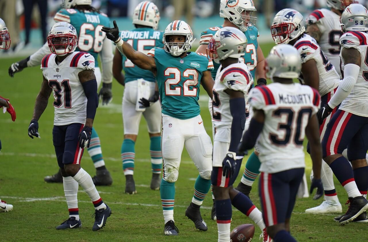 Miami Dolphins running back Matt Breida signals for first down vs. New England Patriots in December 2020