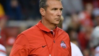 Coach Urban Meyer says he'll be back at Ohio State next year
