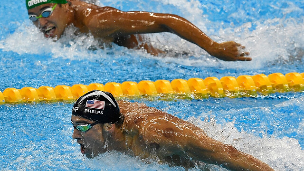Michael Phelps wins Olympic gold medals 20, 21