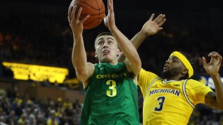 No. 10 Oregon outlasts No. 5 Michigan in OT