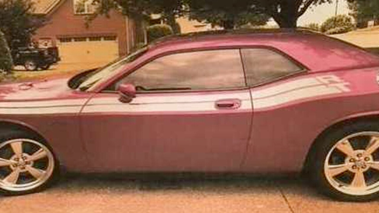 Fuchsia Dodge Challenger Stolen From Couple's Driveway