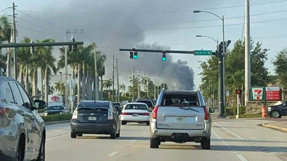 Smoke could be seen from U.S. 1 after fire engulfed a yacht in Riviera Beach on May 7, 2019.