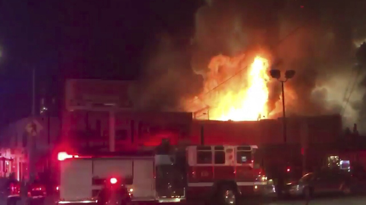Fire kills at least 33 at Oakland warehouse where party was held, dozens still missing