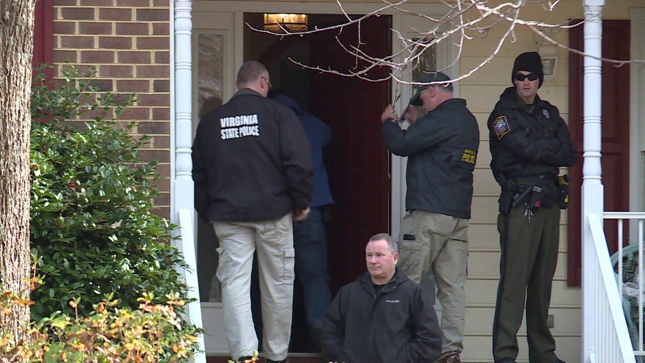 Murder suspect's son taken into custody duringraid