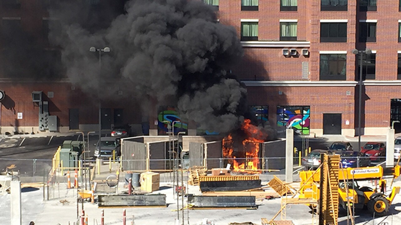 Crews work to extinguish massive dumpster fire