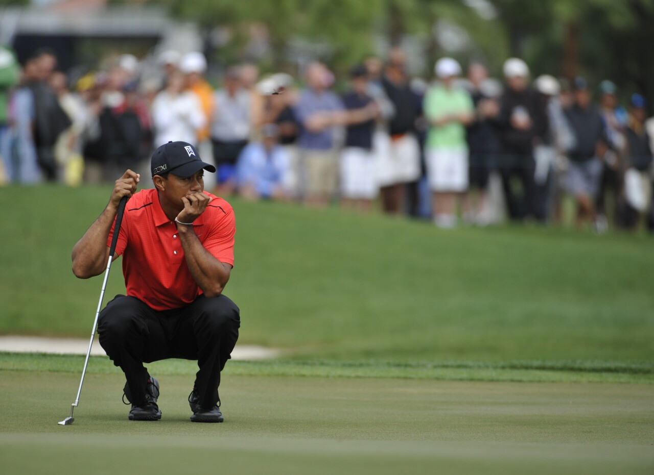 Tiger Woods waits to putt on 10th hole in final round of 2012 Honda Classic