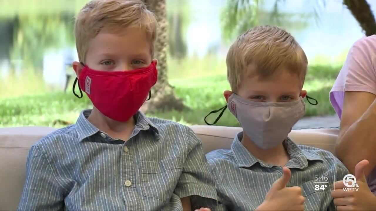 Lizzy and Chris Toth's children wearing masks