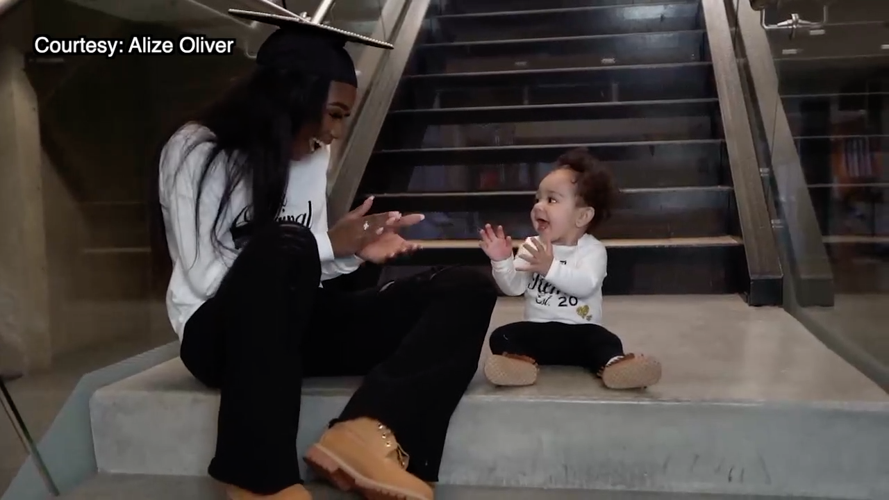 Alize Oliver and baby Bailey.png