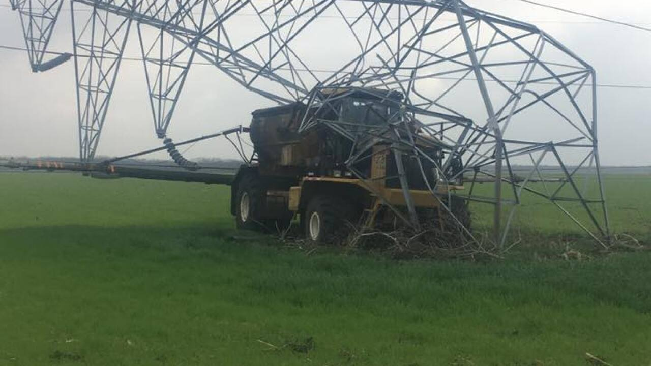 Tractor knocks over transmission tower