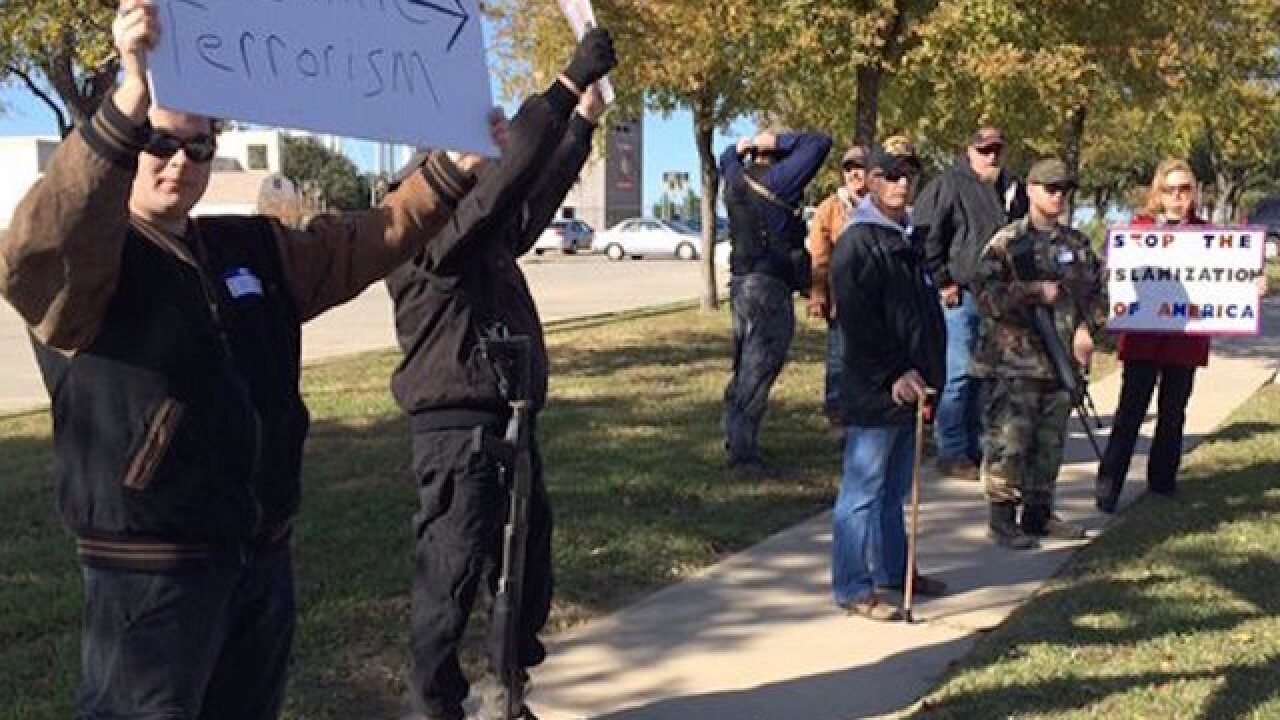 Armed 'patriots' turn protests toward Muslims