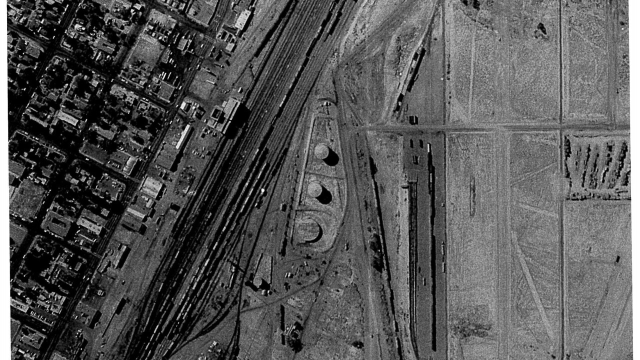 This is an aerial image from 1969 showing what would become the present day location of the Clark County Government Center. The property was used to dump oil, fuel and other chemicals used in the former railyard.