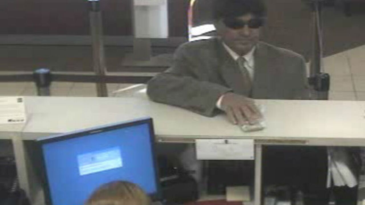 Cops: Man wearing 'possible toupee' robs Henrico bank
