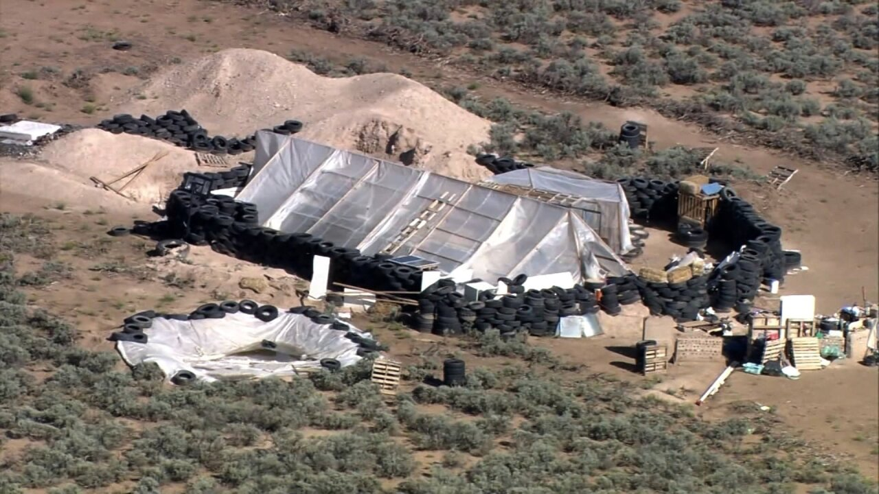 Investigators return to New Mexico compound while suspects wait to bond out