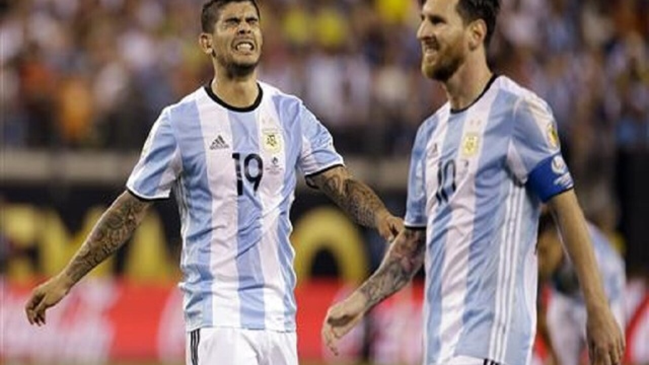 Chile wins Copa; Messi misses, says he is quitting Argentina
