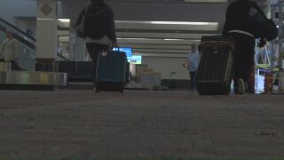 Travelers at the Colorado Springs Airport.