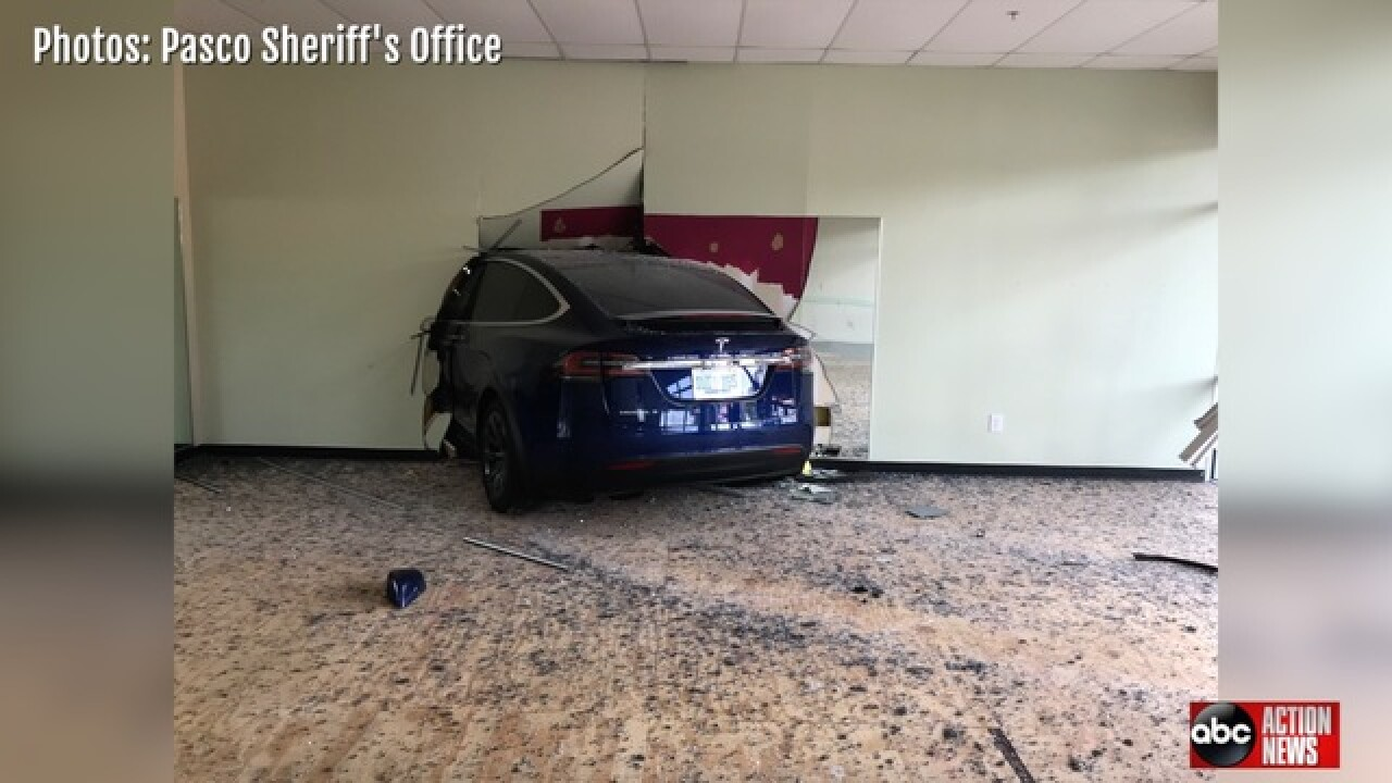 Tesla slams through wall of Florida gym
