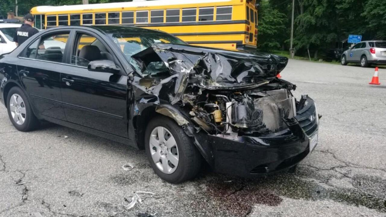 1 injured; bus driver cited in school bus crash outside ManchesterHigh
