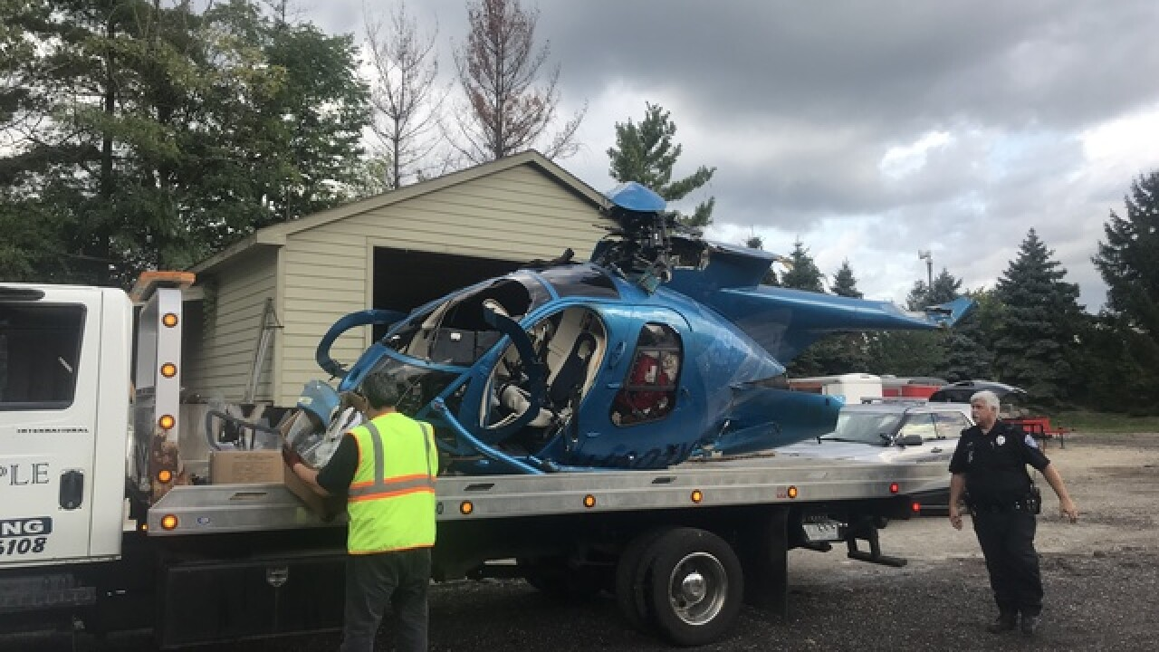 Pilot rescued from helicopter crash