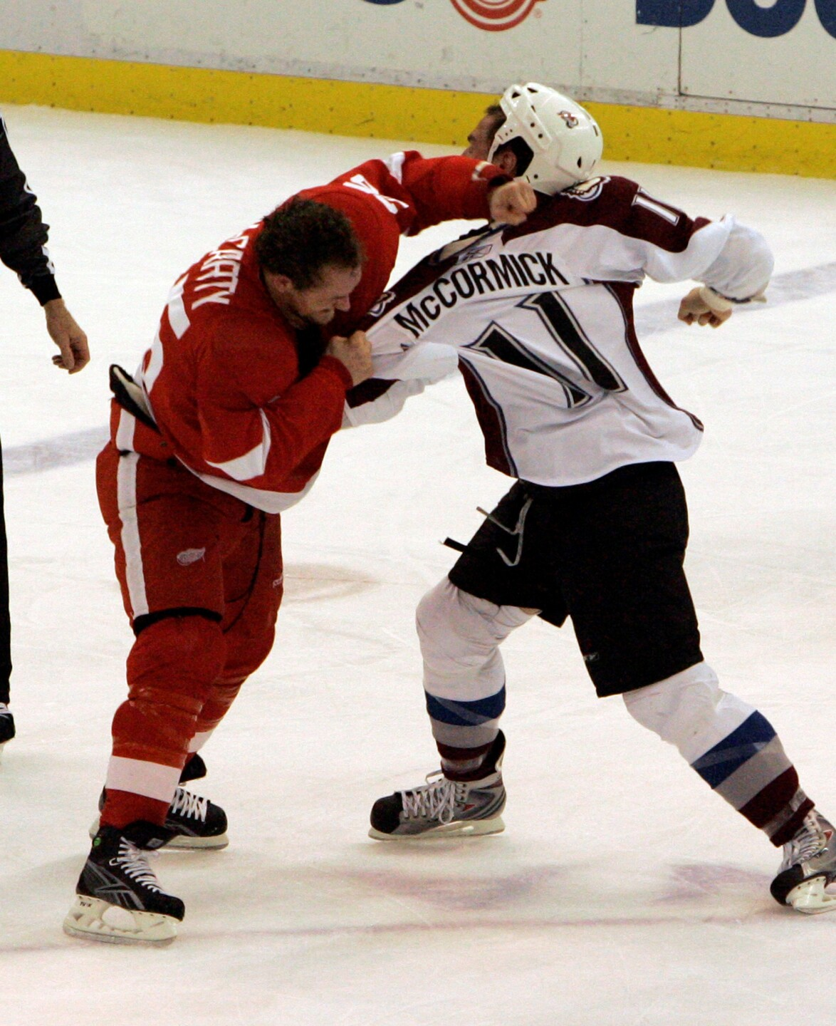 Darren McCarty drops the gloves against the Avalanche