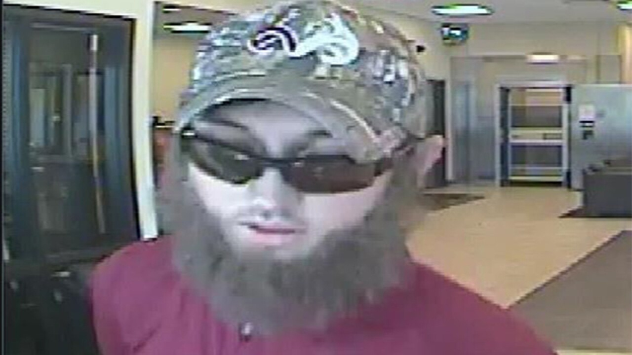 KeyBank robber on the loose in Castle Pines